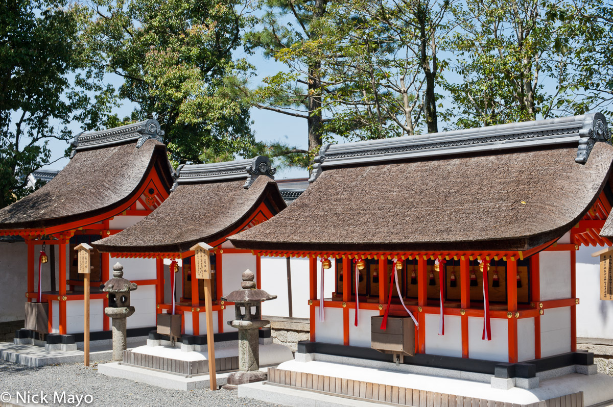 Thatched shrines in the grounds of Fushimi Inari Taiasha.