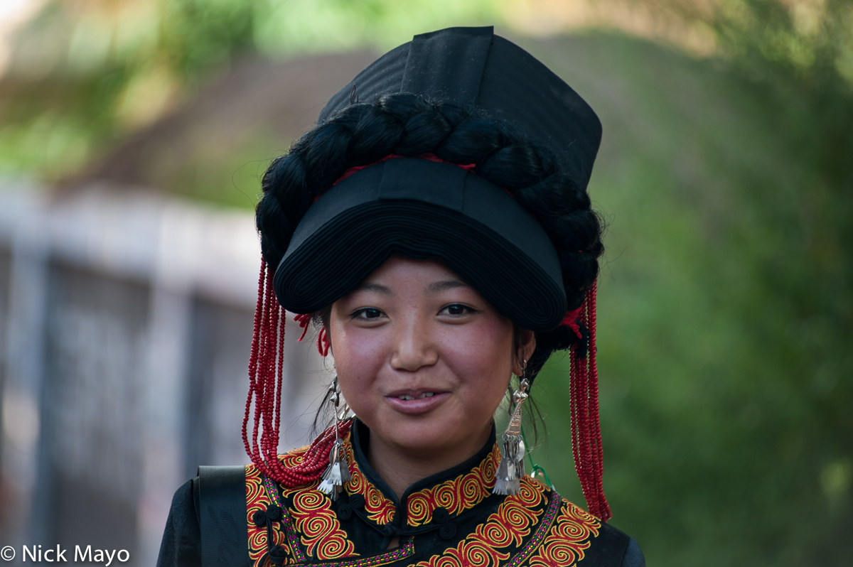 A Yi woman at a festival in the Daliangshan village of Hubo Luo.
