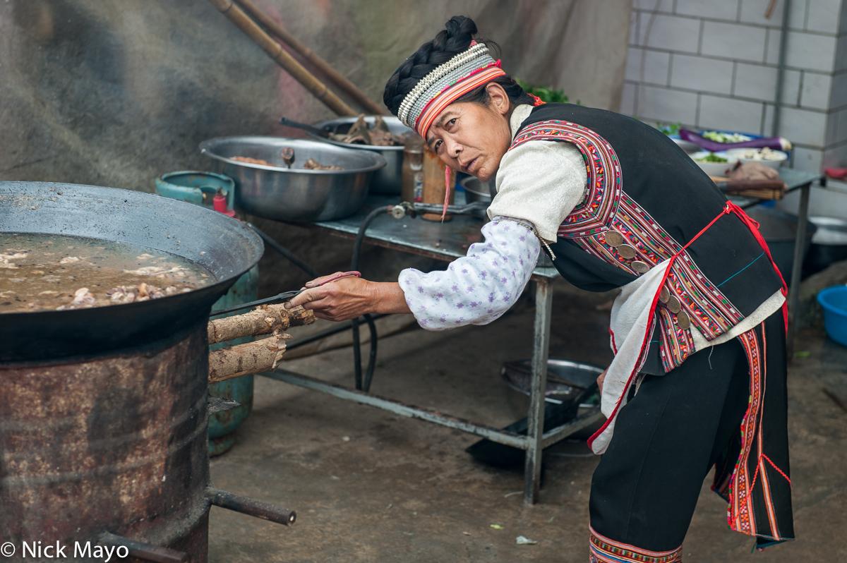 China,Cloth Backpiece,Cooking,Hair Piece,Hani,Hat,Market,Wok,Yunnan, photo