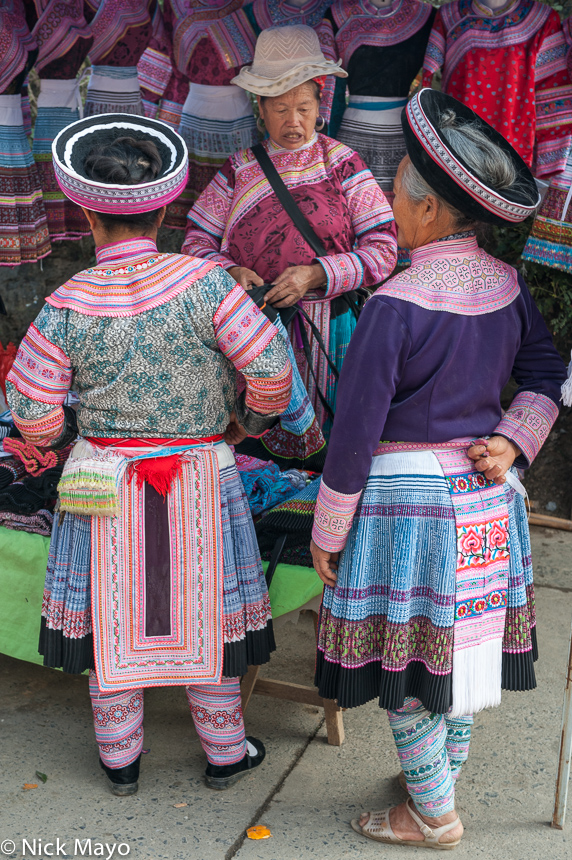 China,Cloth Backpiece,Hat,Leggings,Market,Miao,Shopping,Yunnan, photo