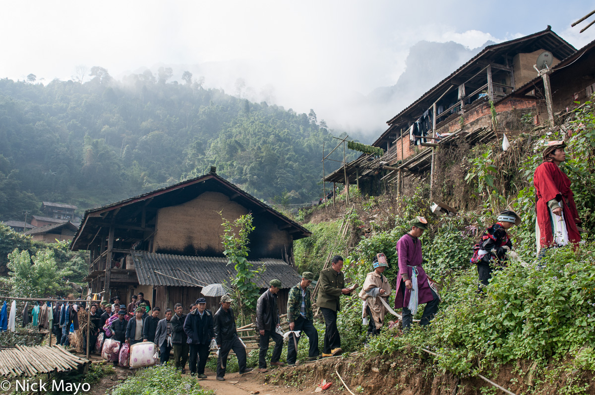 A dujie procession, led by a san mienh (Yao priest), through the village of Ku Ju Jie.