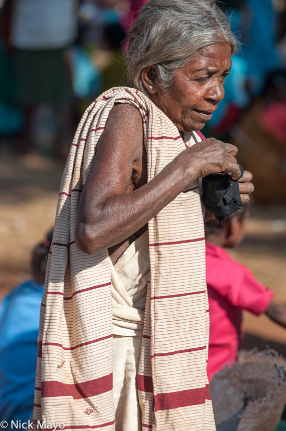 A Botra woman of the Gond ethnicity in traditional dress at Madum market.