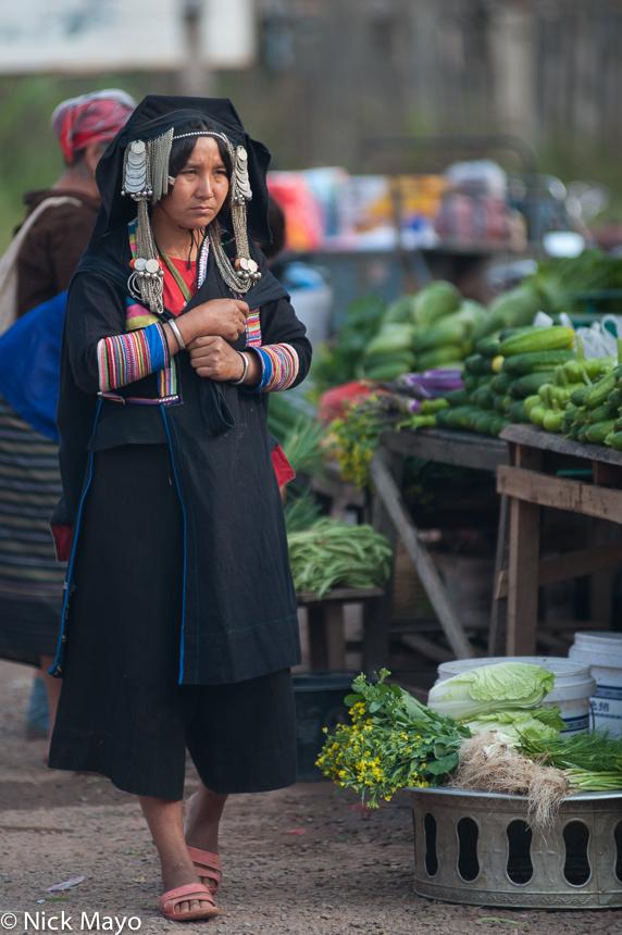 An Akha Pixor (Hani) woman in Boun Yo market.