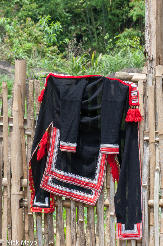 A Red Dao (Yao) jacket hung on a fence in the village of Nam Son.
