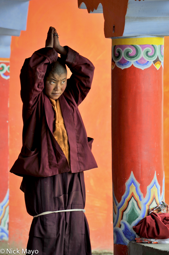 A Tibetan nun praying at the Larung Gar academy in Sertar.
