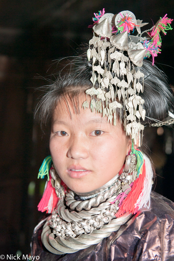 A Miao bride at her wedding in the village of Gui Lai.