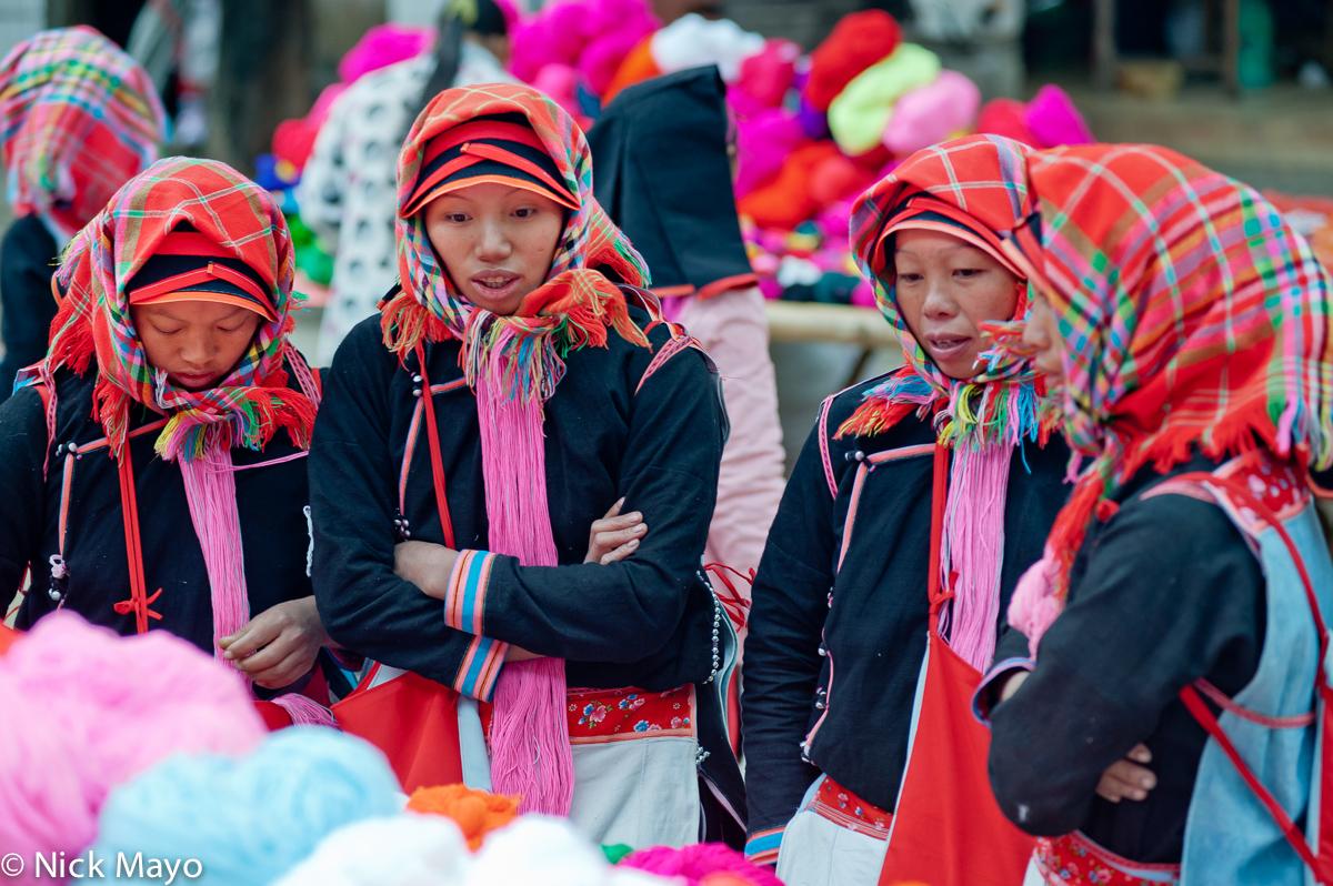 Four Yao woman from Vietnam shopping at Nafa market.