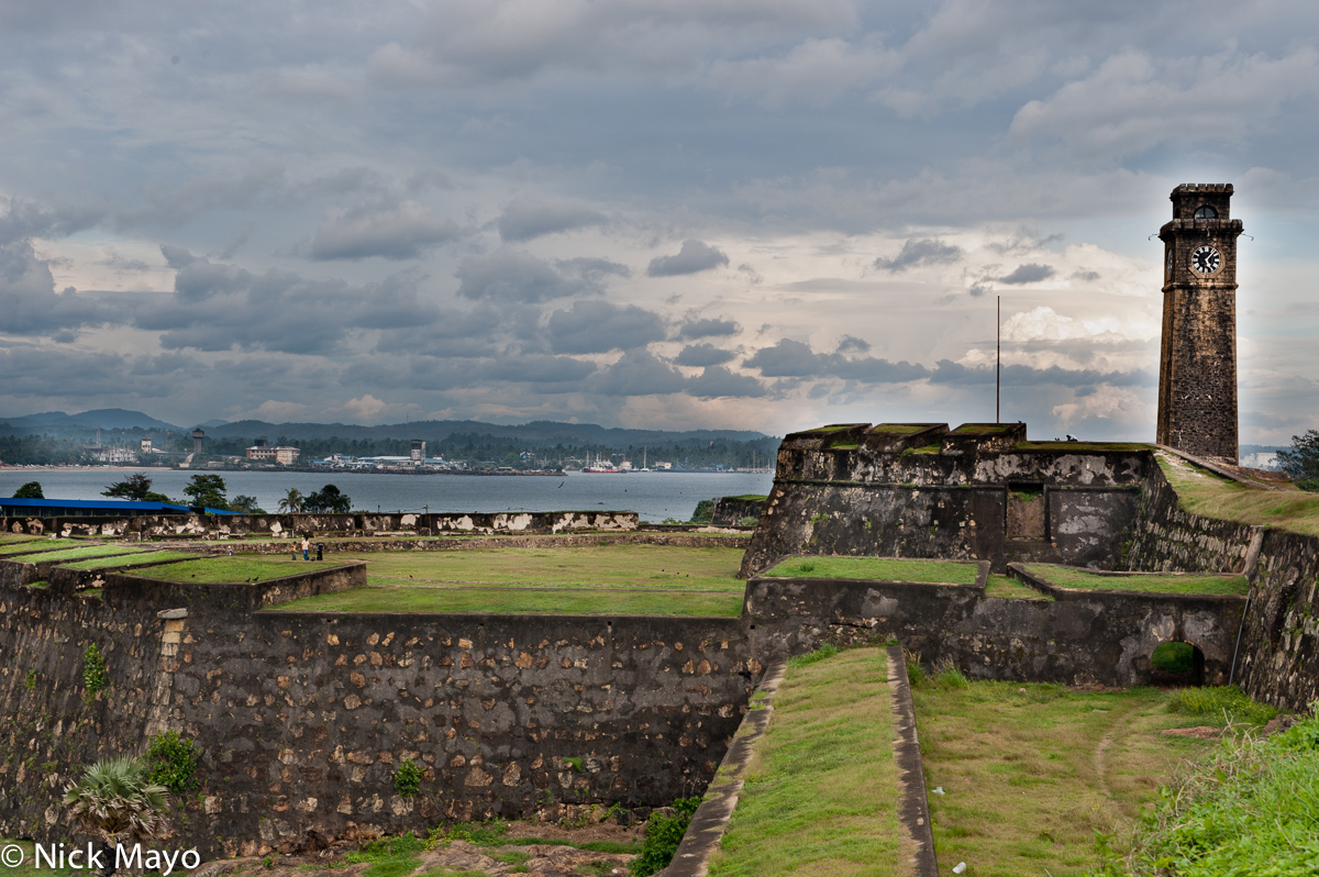 The port behind the clock tower and fort walls at Galle.