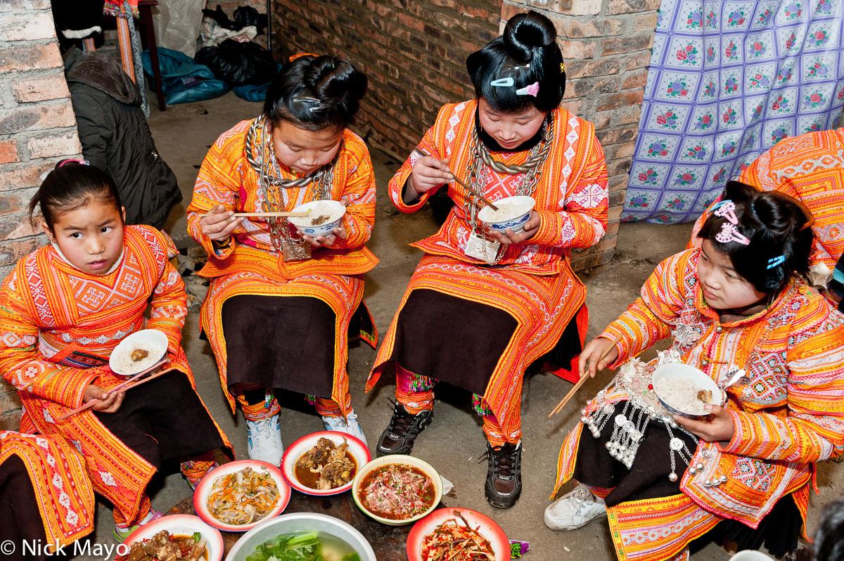 Apron,China,Eating,Guizhou,Hair,Miao,Necklace,Rice,Wedding, photo