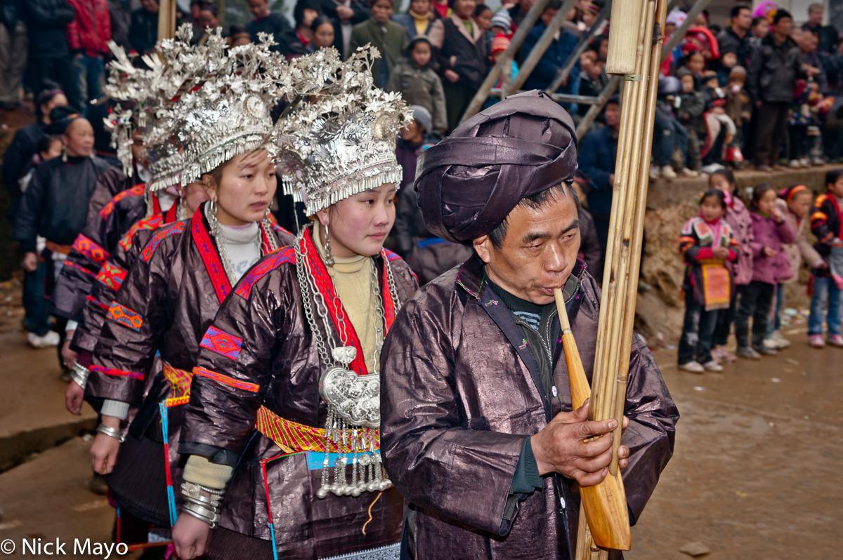 Breastpiece,China,Circling,Earring,Festival,Guizhou,Headdress,Miao,Piping,Turban, photo