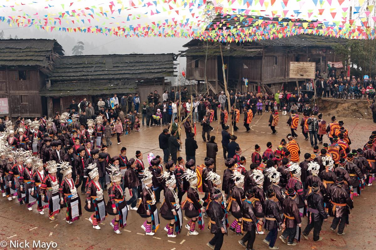 Apron,Baby Carrier,Breastpiece,China,Circling,Festival,Guizhou,Headdress,Leggings,Miao,Piping, photo