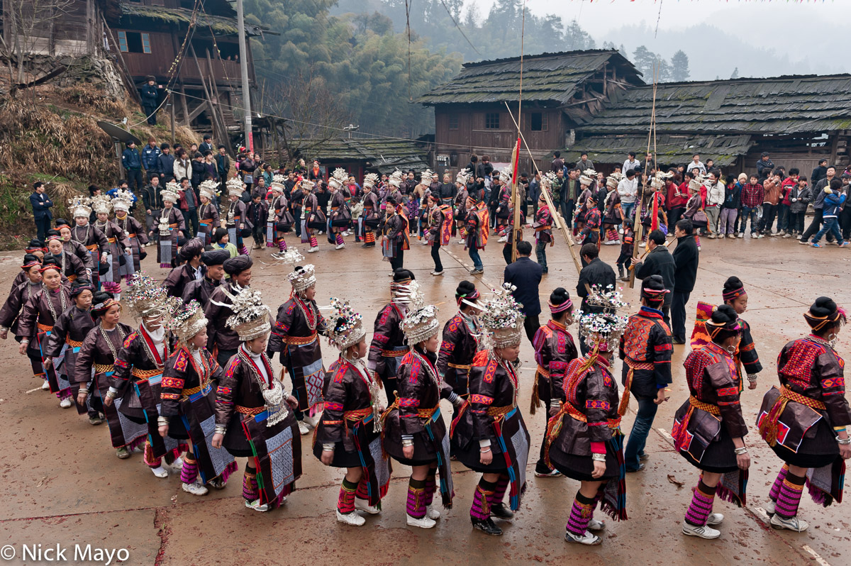 Apron,Breastpiece,China,Circling,Festival,Guizhou,Hair,Headdress,Leggings,Miao,Piping, photo