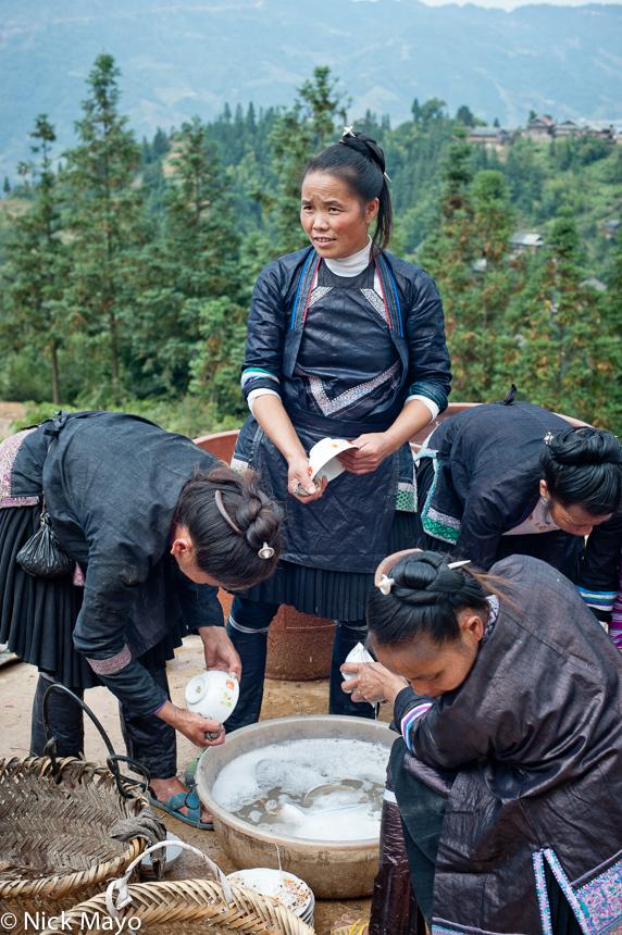 China,Guizhou,Housewarming,Miao,Washing Up, photo