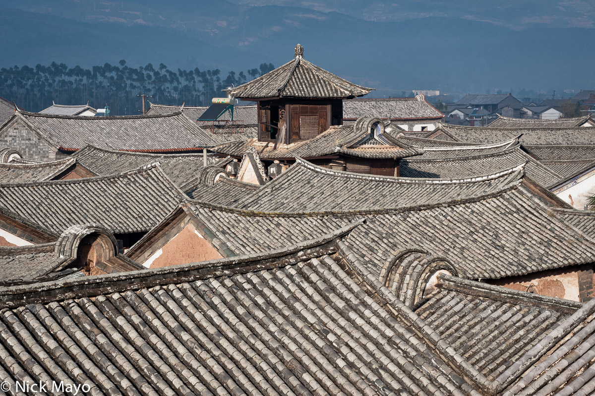 Grey tiled swallow tail roofs and a hexagonal look out in the historic Muslim village of Donglianhua.