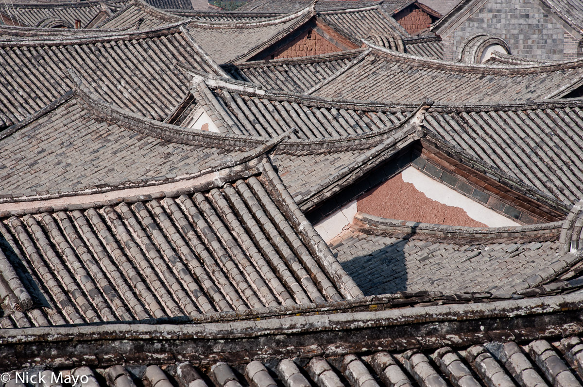 Grey tiled swallow tail roofs in the historic Muslim village of Donglianhua.