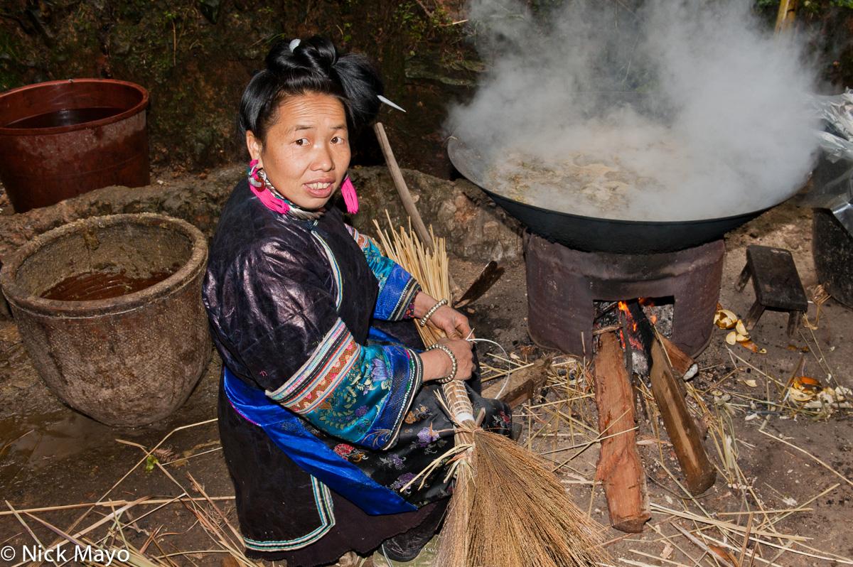 China,Cooking,Guizhou,Miao,Necklace,Wok, photo