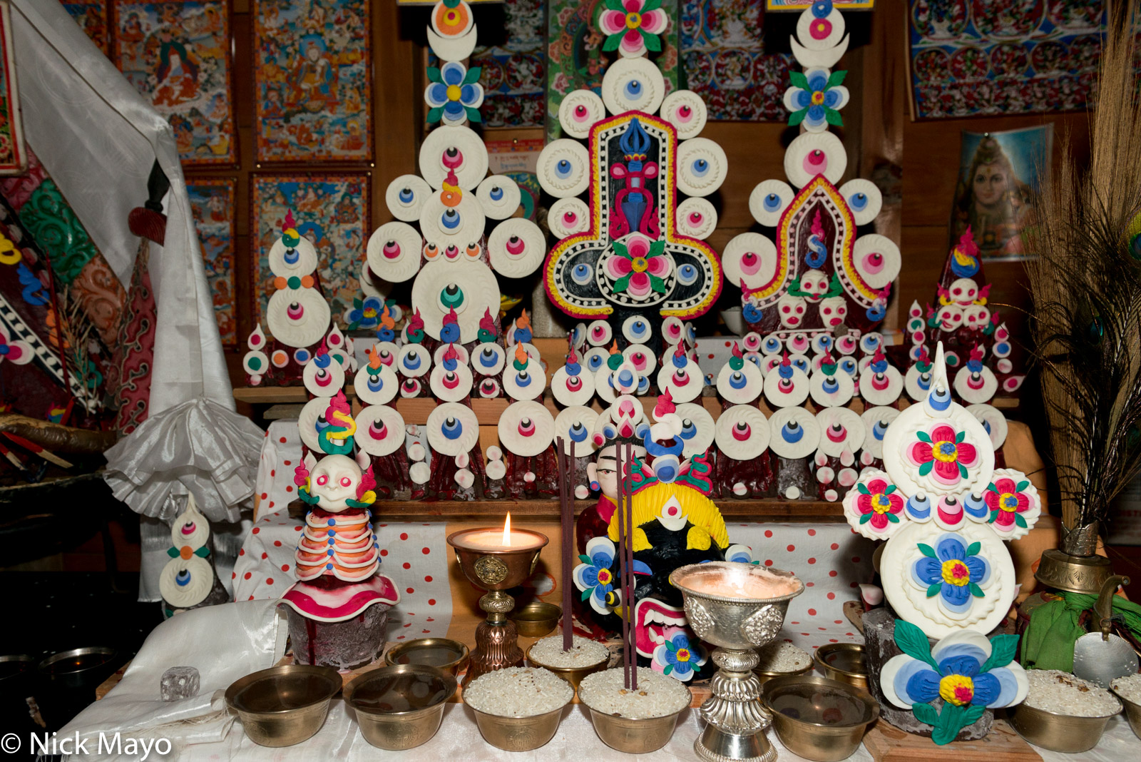 """Buddhist butter sculptures (""""tormas"""") on a household shrine in Mechukha."""