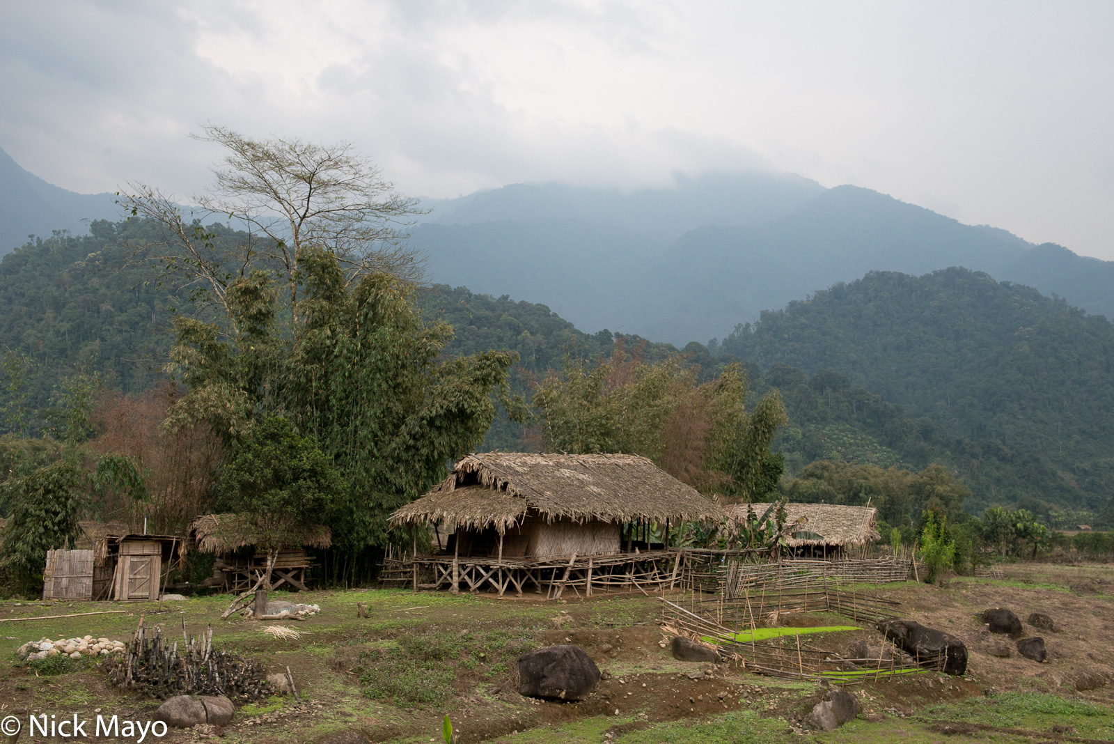 A thatched Galo house in the fields outside Kaying.