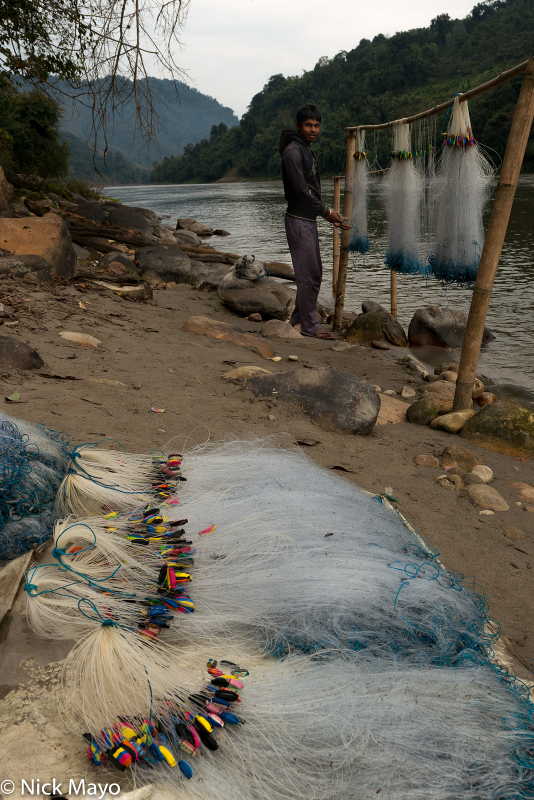 Fishing nets being prepared at Paya in the Siyom valley.