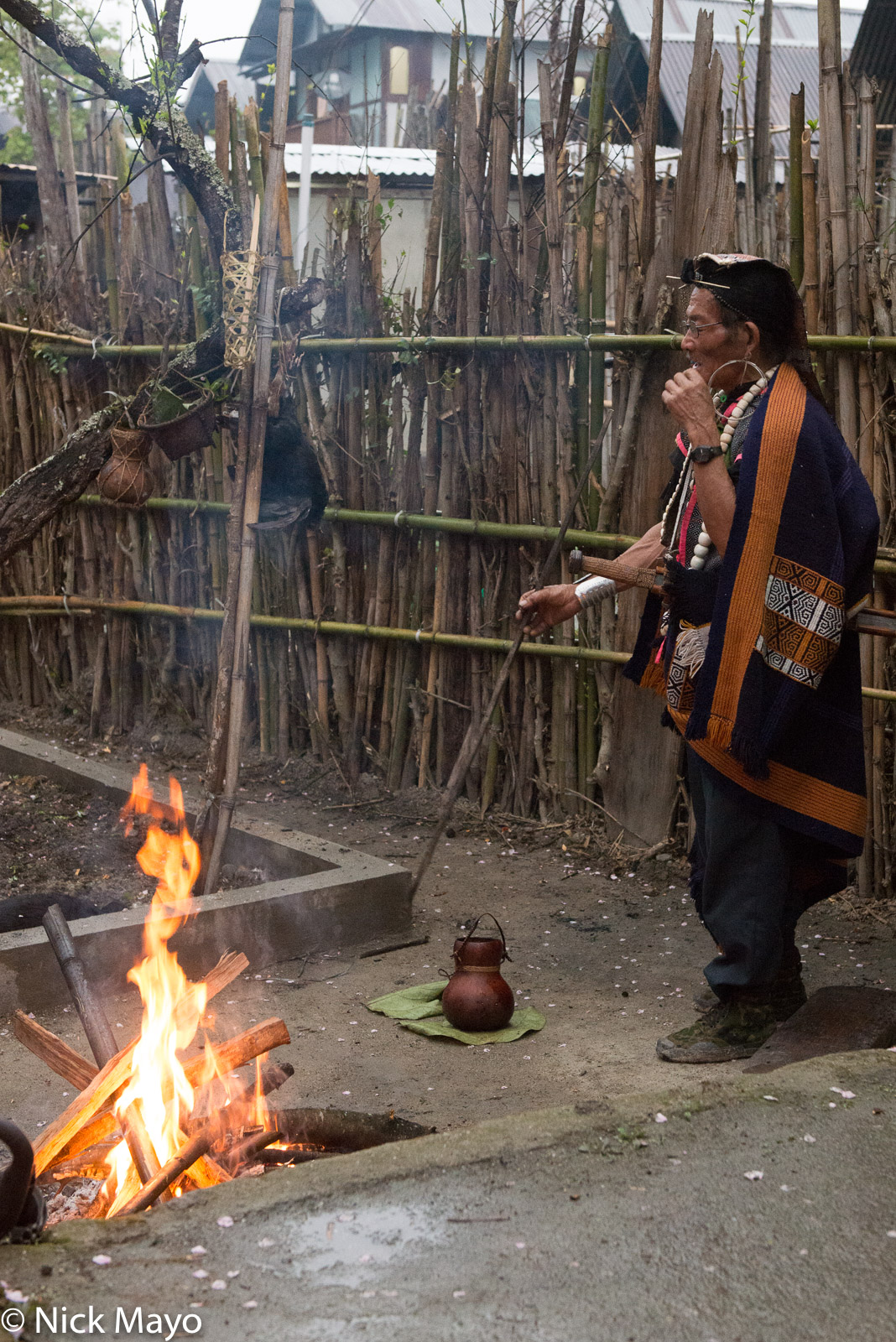 An Apatani priest performing a religious ritual during the Myoko festival at the Ziro valley village of Mudang Tage.