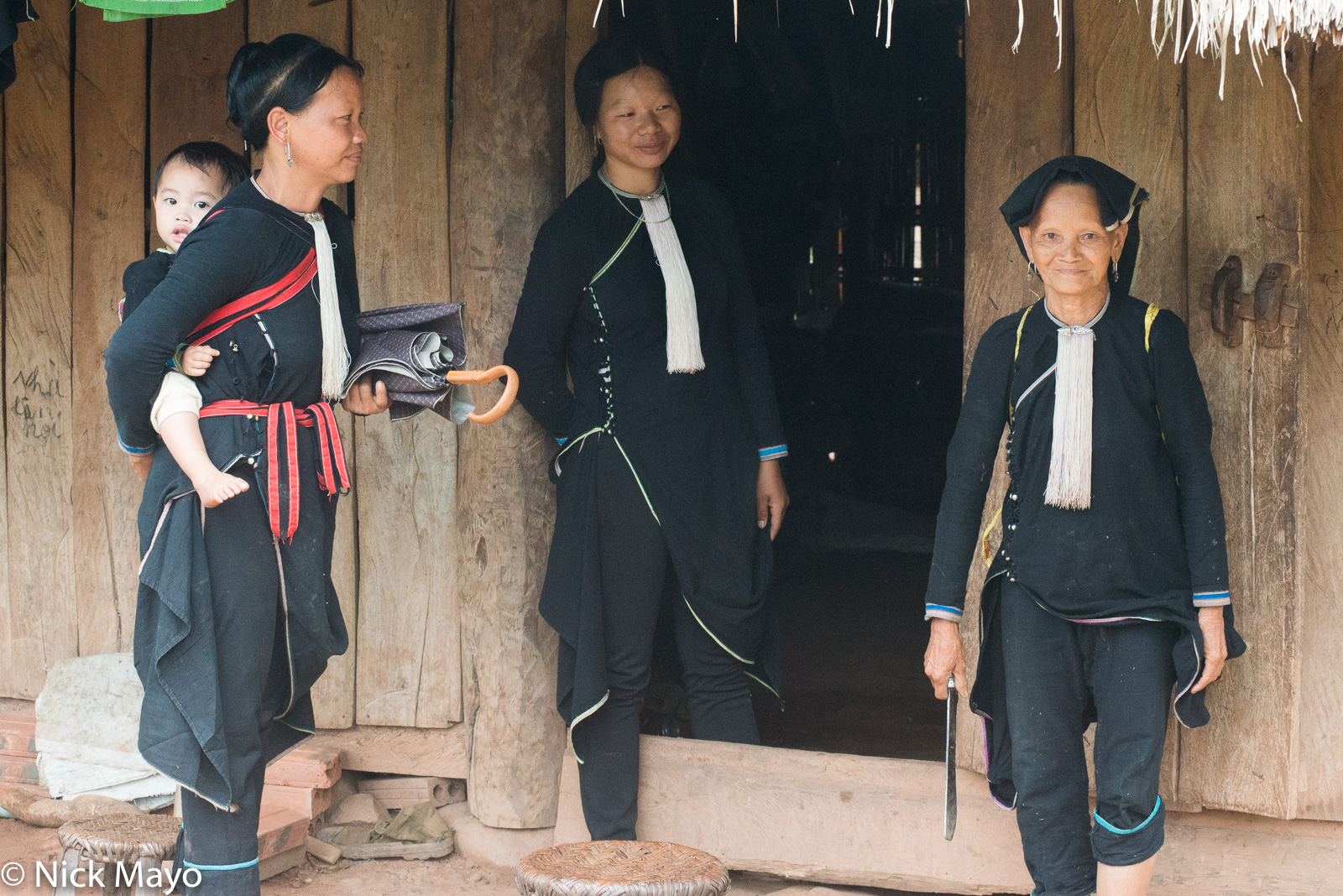 Three traditionally dressed Lantien Dao women in the Nam Ma valley.