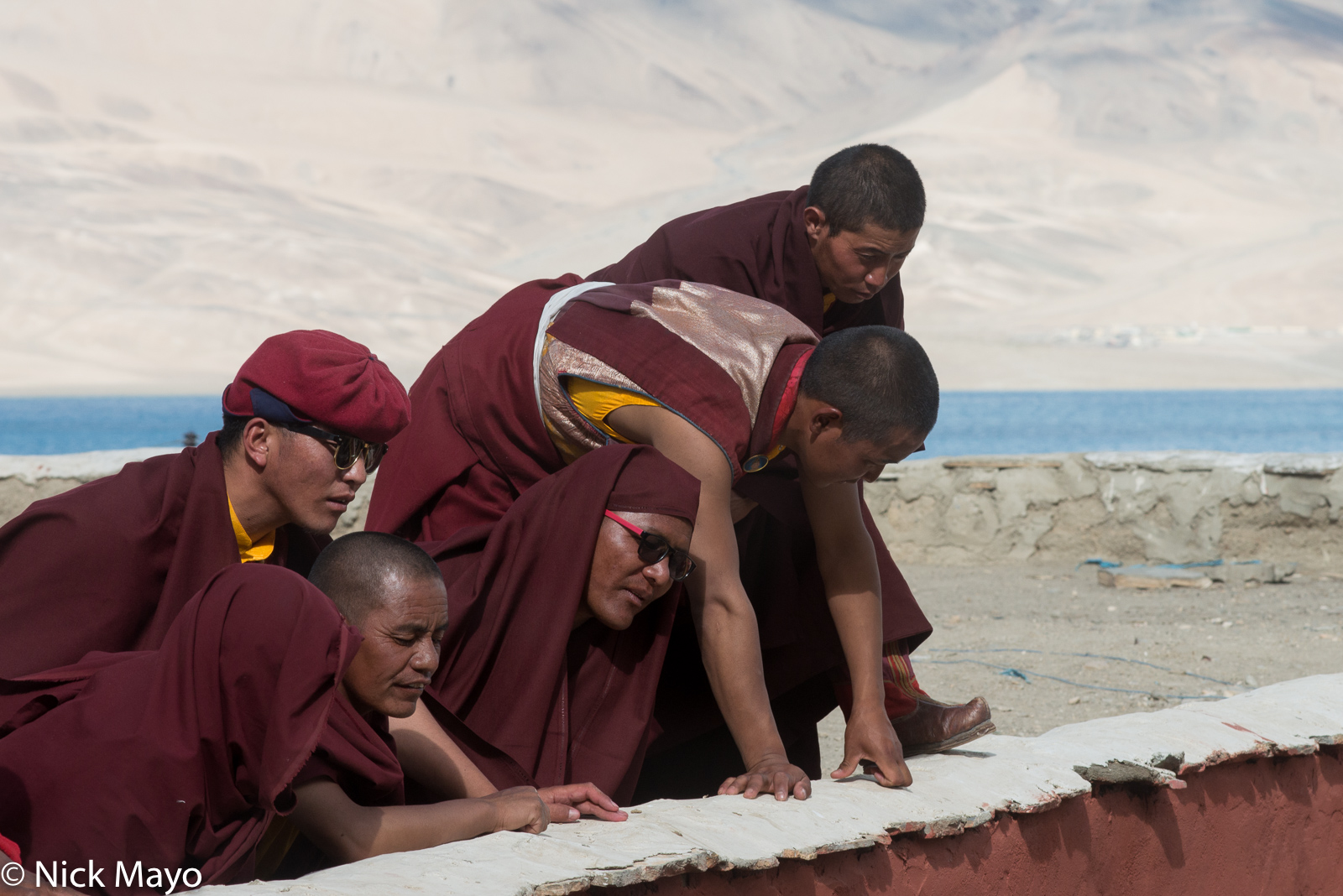 Changpa monks watching the dancing during the annual Korzok Gustor.