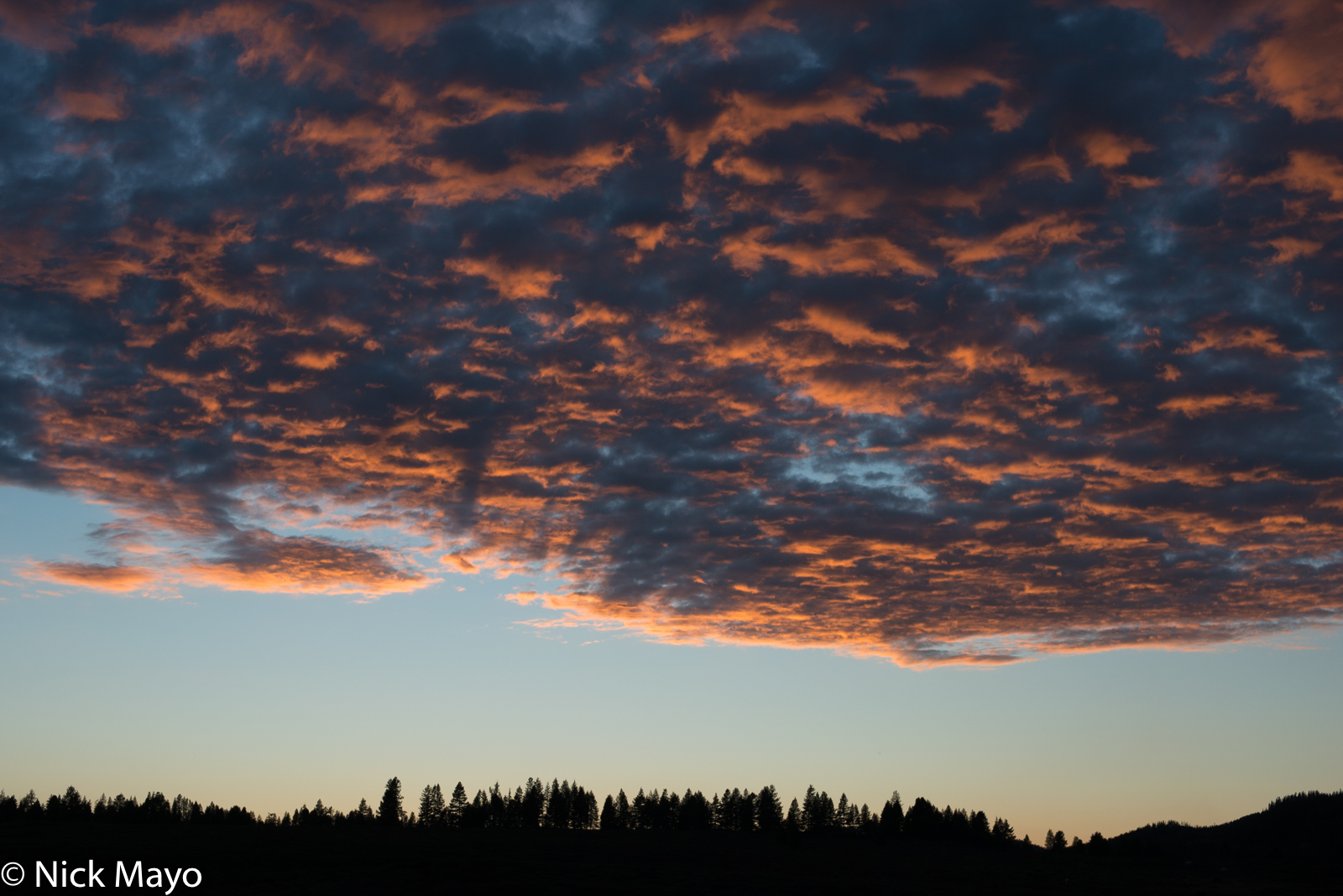 A spectacular autumn sunset over the taiga in Tsagaannuur sum.