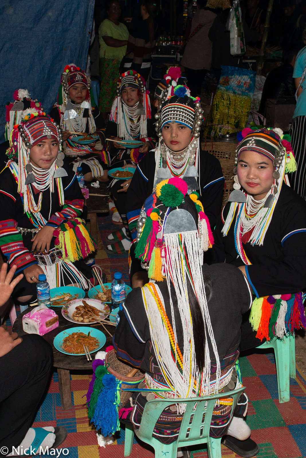 Young Akha (Hani) women having dinner at a festival in Kengtung.