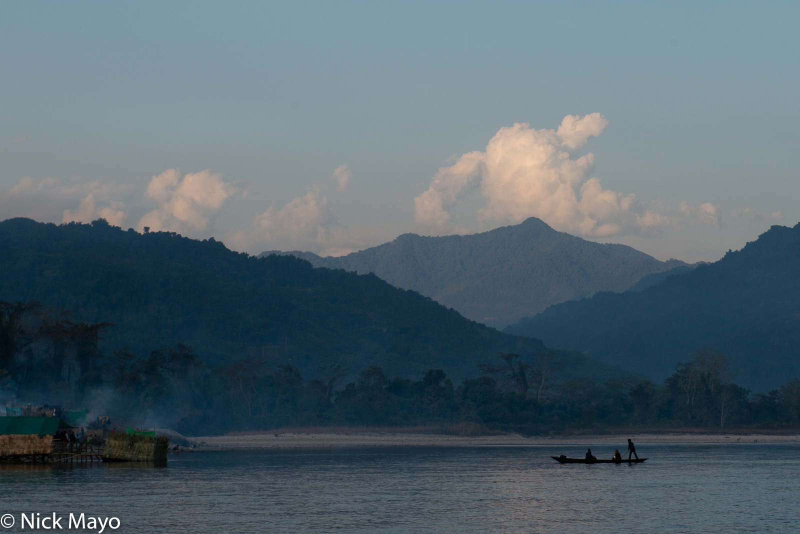 A boat being rowed across the Siang river at Aalo just before dusk.