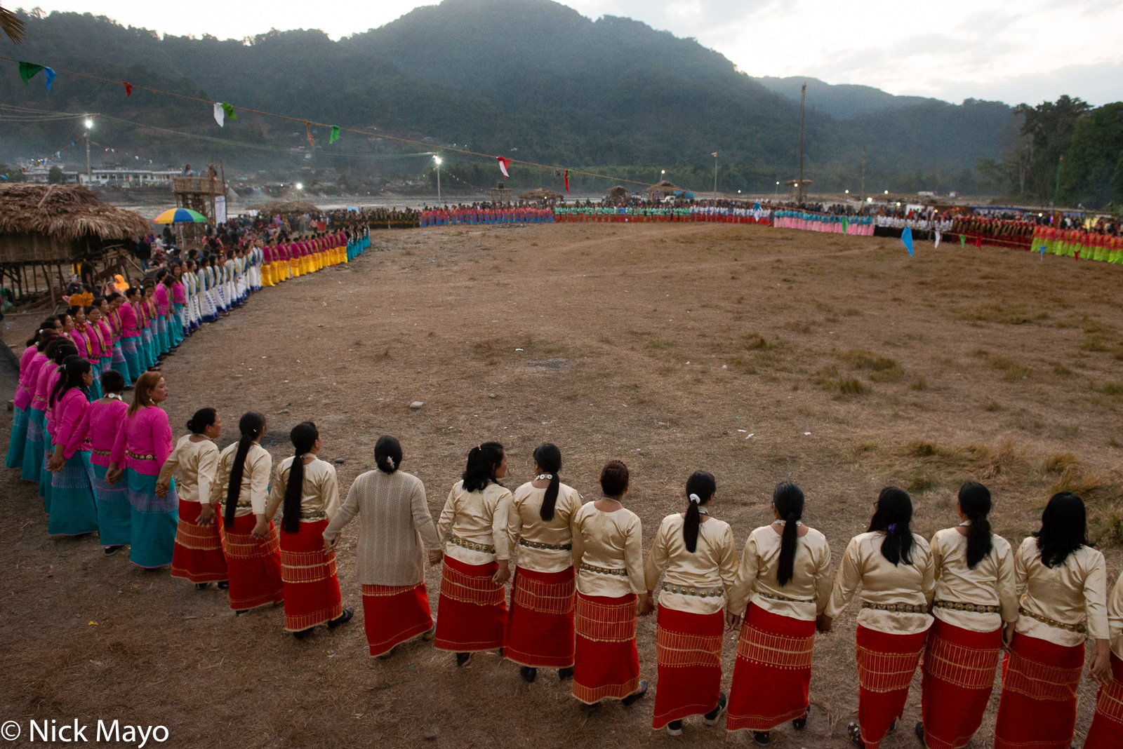 The large circle of dancers on opening night of the Galo festival of Yomgo held at Aalo in the Siang valley.