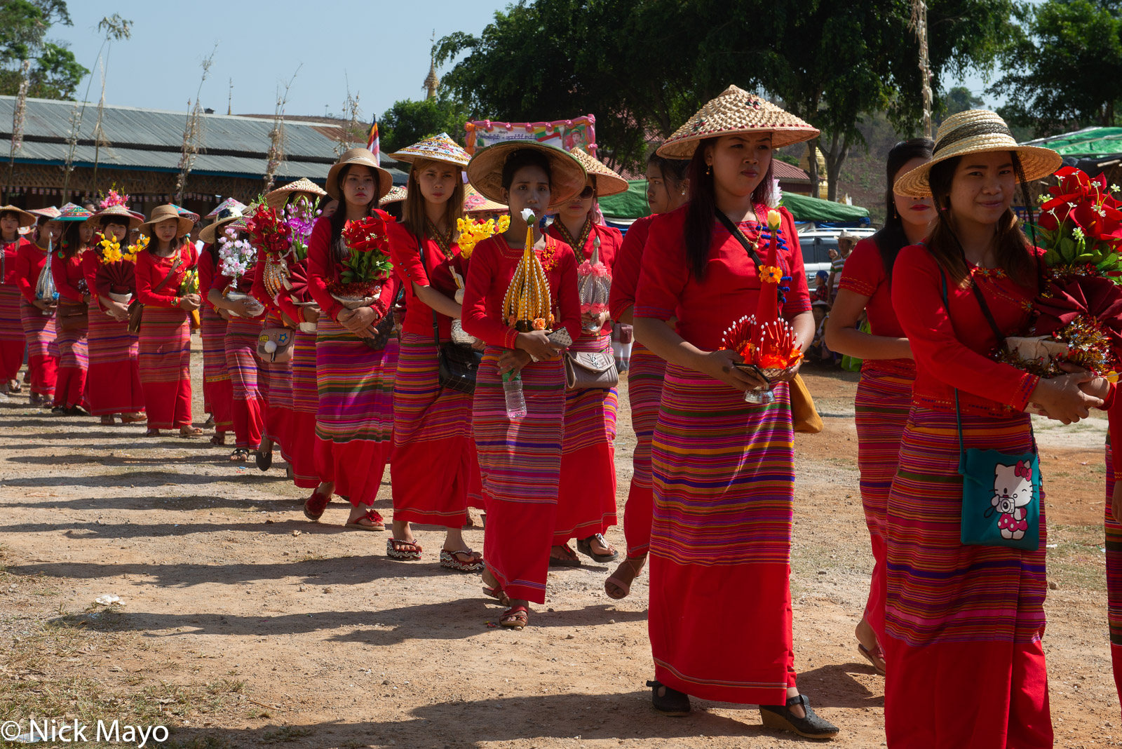 A procession of Shan women during a shinbyu (novitiation ceremony) at Phan Khao.