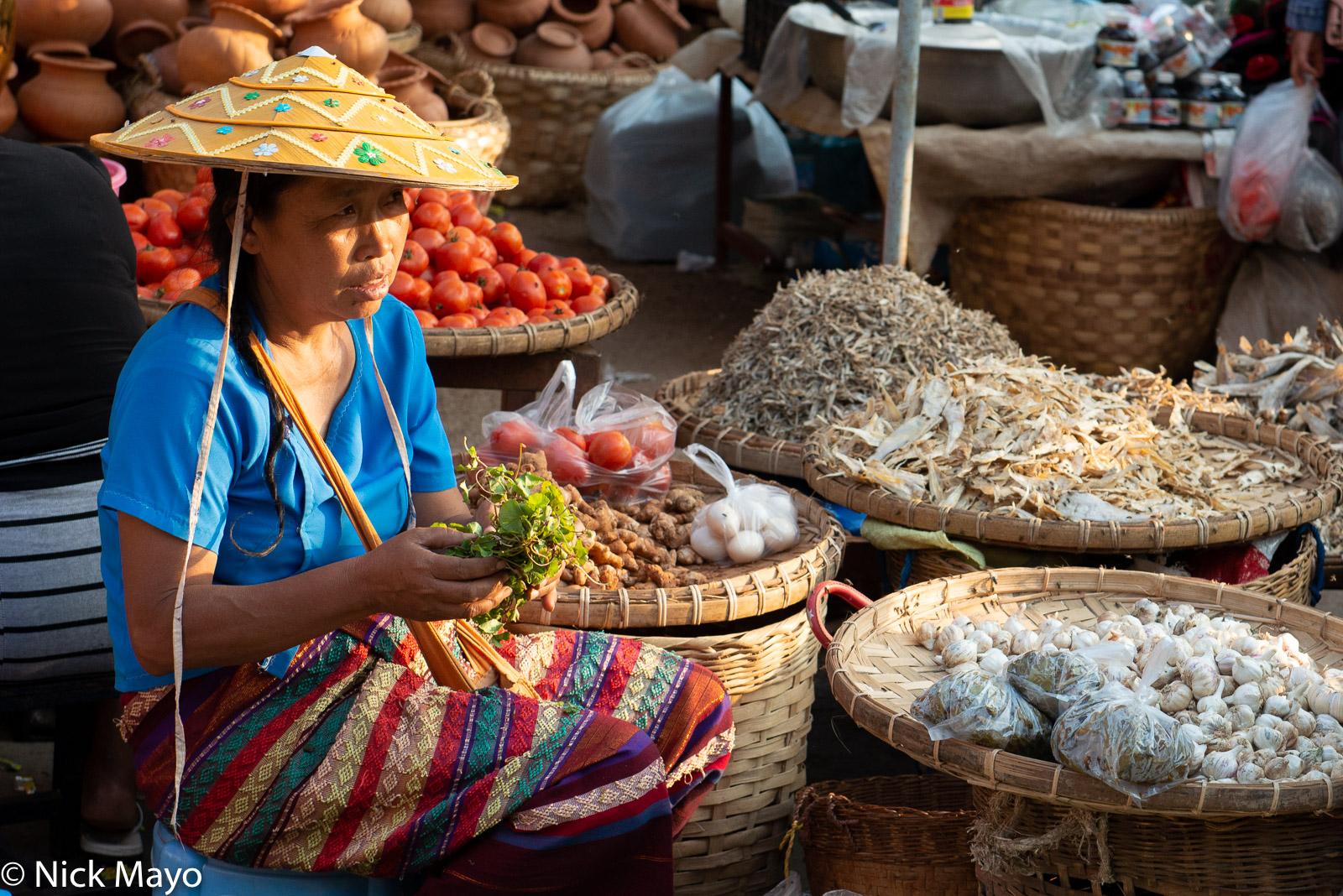 A Shan market vendor selling vegetables at Kyaukme.