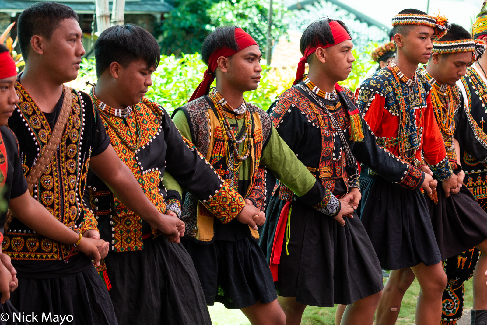 Young men dancing in traditional fashion at a Paiwan harvest festival in Taimali in Taitung County.