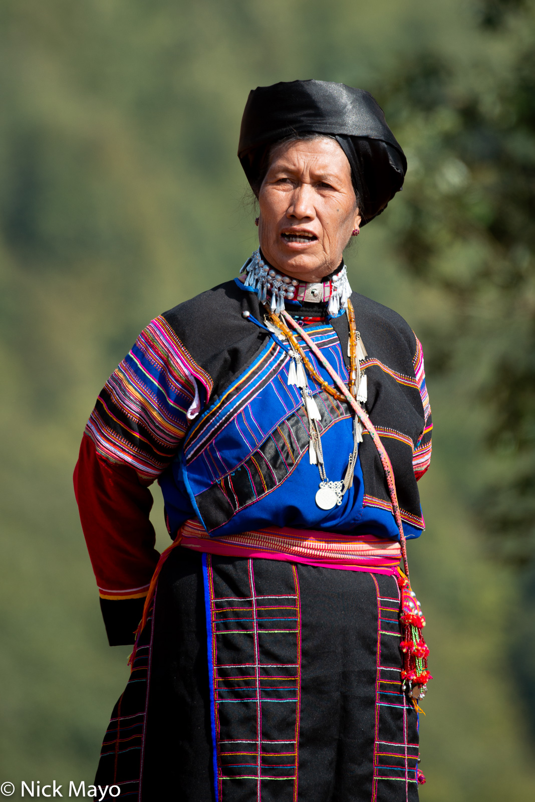 A woman in her best traditional clothes at a New Year festival in Mogok.