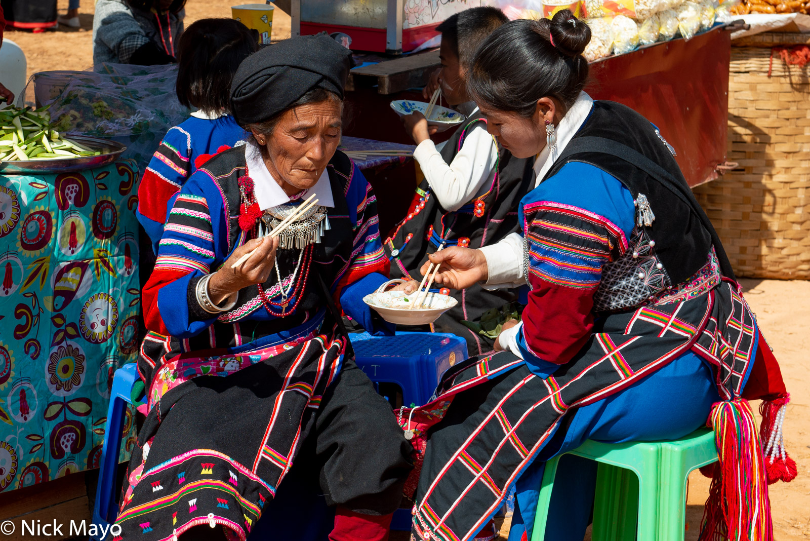 Lisu women eating noodles for breakfast at their New Year festival in Mogok.