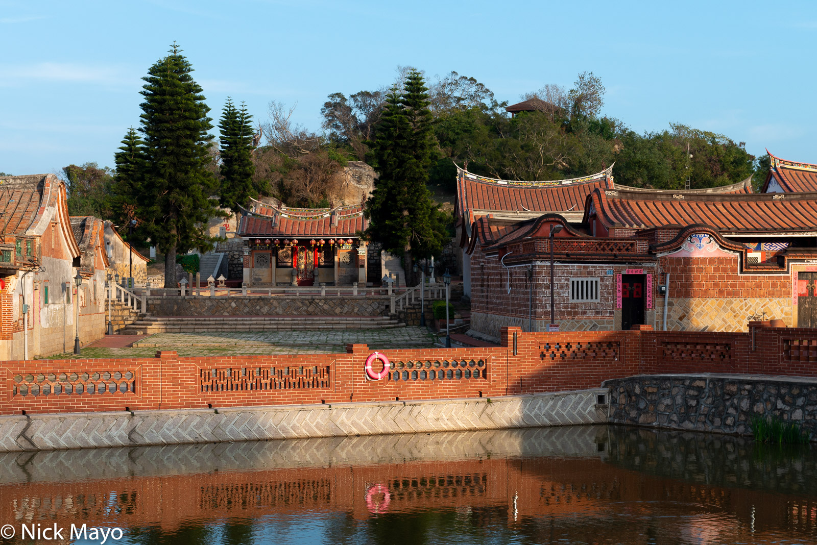 The temple and Minnan style village houses with their distinctive roofs at Zhushan on Kinmen.