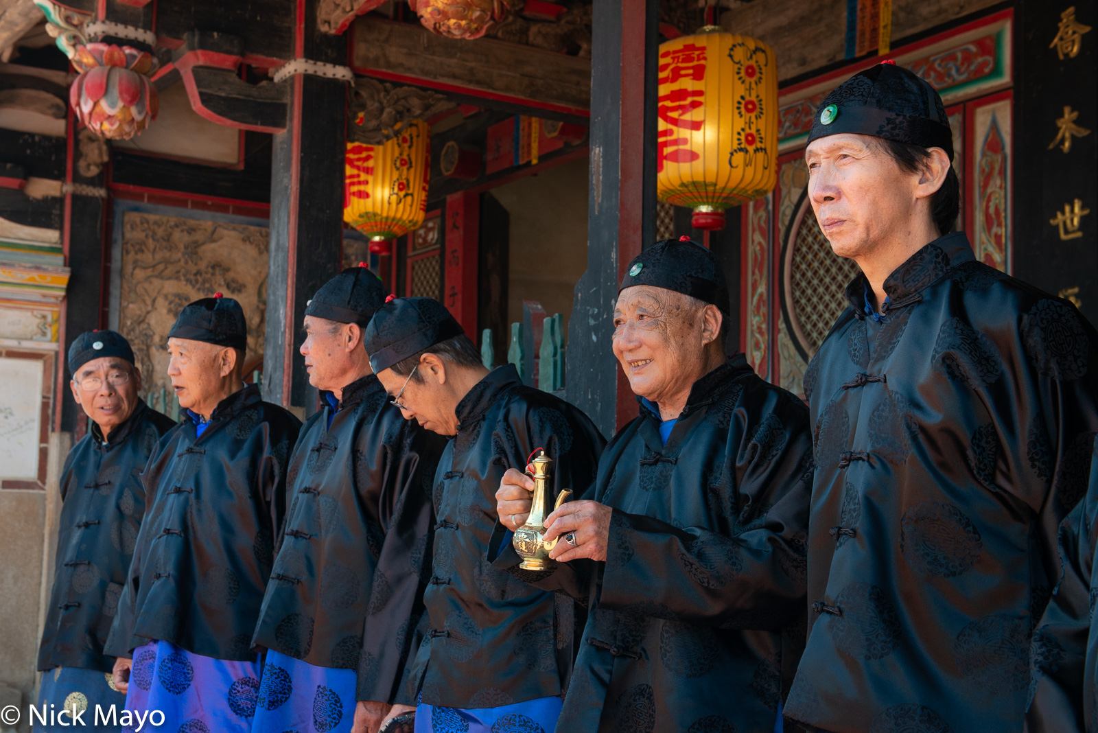 Elders of the Tsai clan participating in a religious ritual at the temple in Qionglin village on Kinmen.