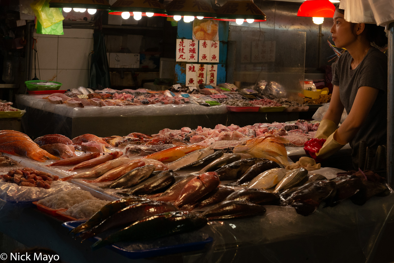 A woman selling fish at the seafood market in Donggang in Pingtung County.