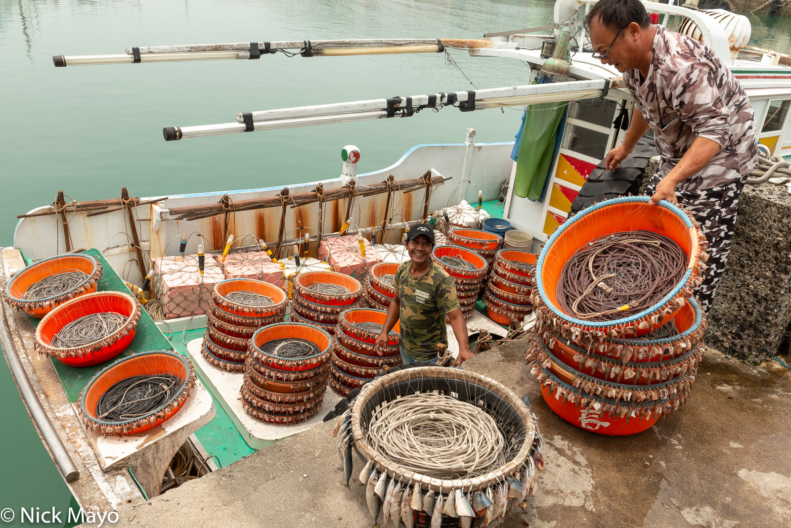 Loading bait lines onto a fishing boat at Beiliao harbour.