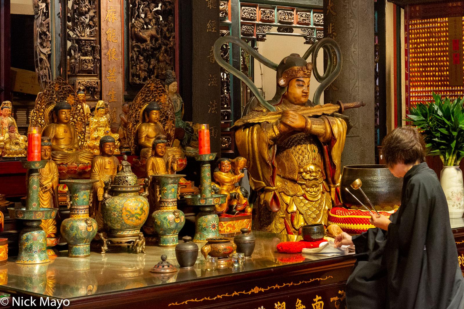 A worshipper performing bai bai at the Tamsui  Longshan temple built in 1858.