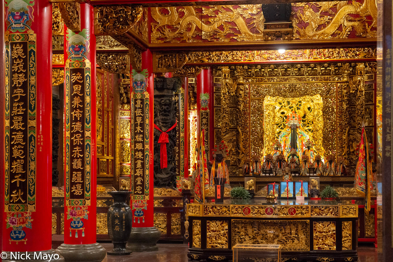 The shrine in the richly decorated Shizhou temple at Nanzhou in Pingtung County.
