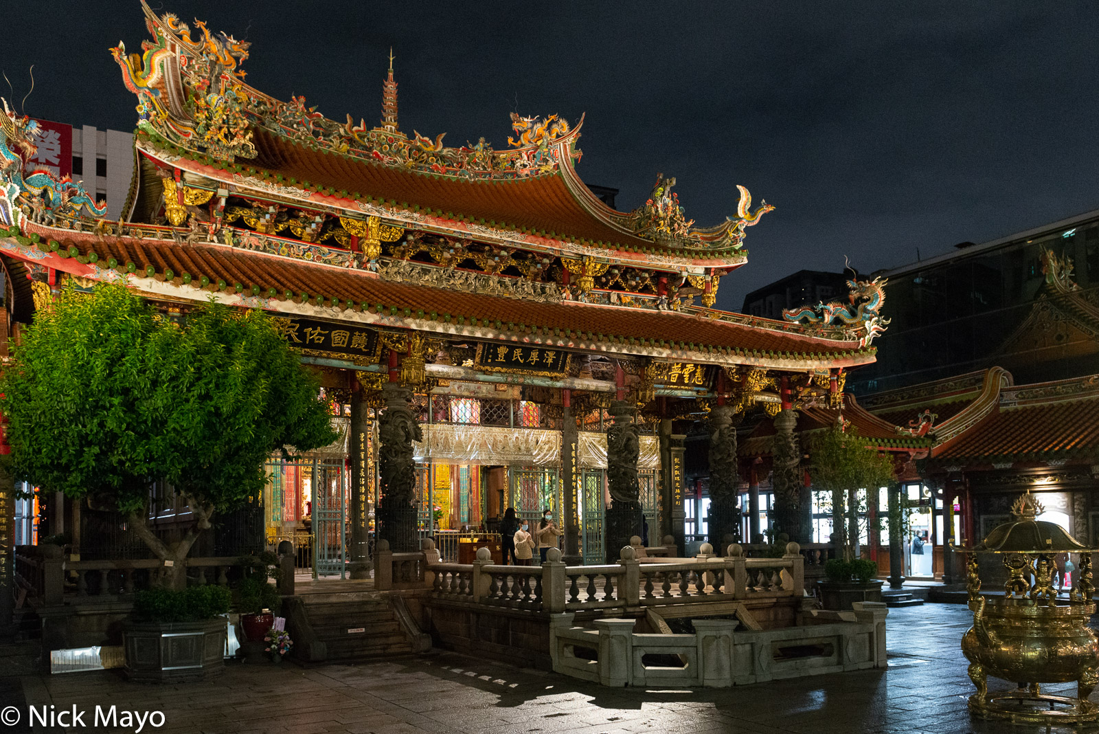 A night view of the Lungshan temple with its ornate roof in the Wanhua district of Taipei.
