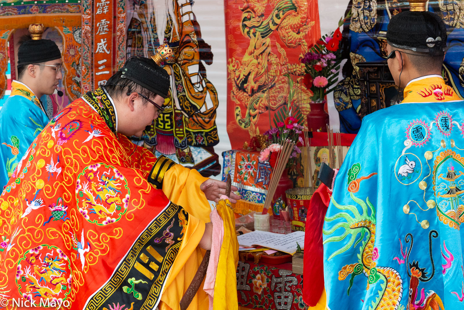 Priests performing a religious ritual at a temple festival in Linkou.