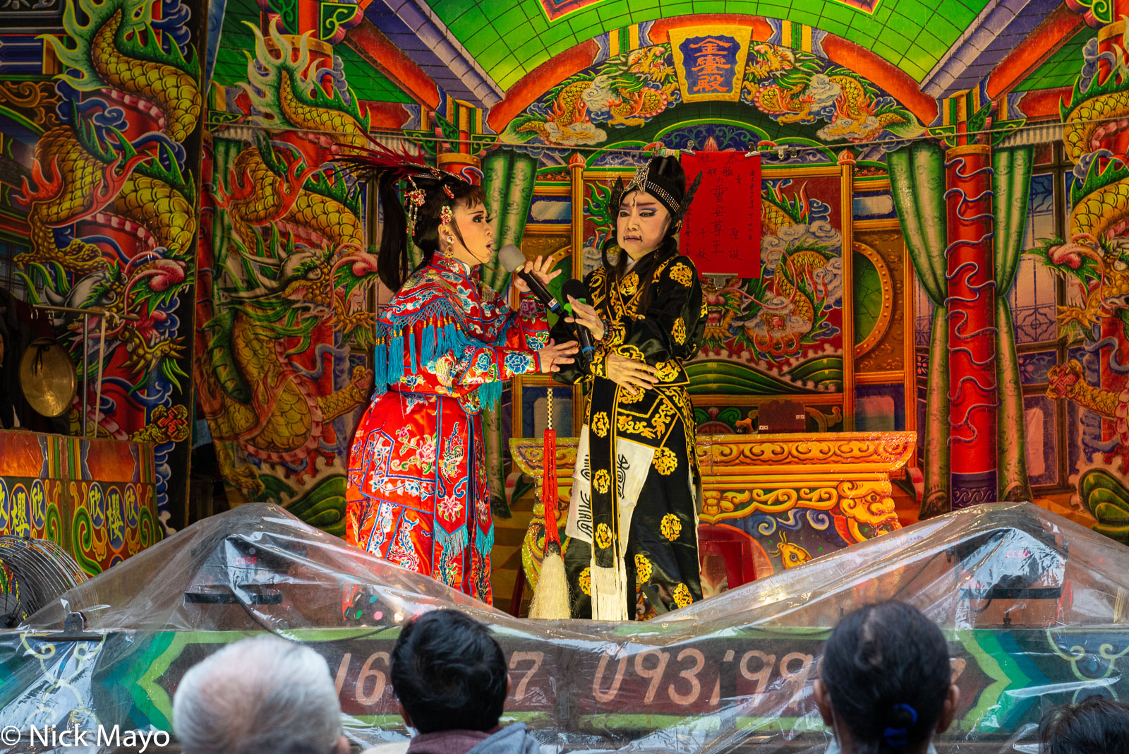Singers in a local ke-tse opera performance during the Qingshan Temple Festival in the Wanhua district of Taipei.