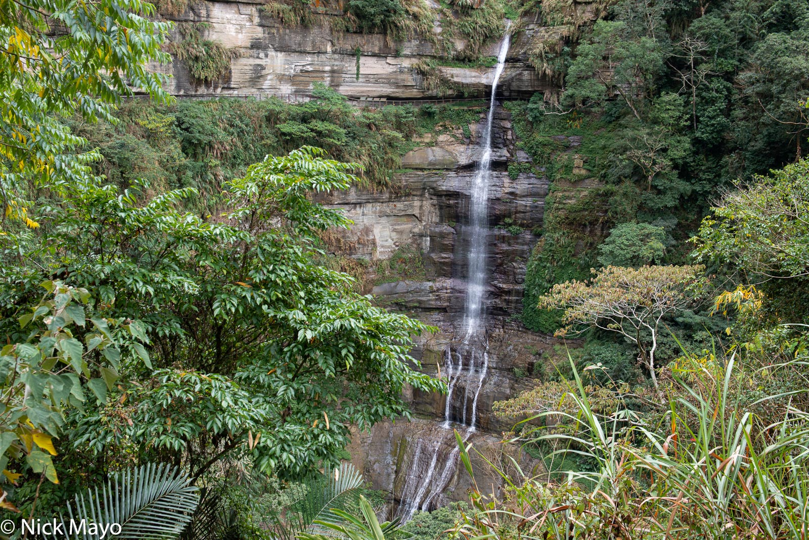 The Langgong waterfall, notable for the walkway passing behind it, at Zhukeng in Chiayi County.
